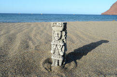 Ancient Maya Statue on the Sand Beach Stock Image