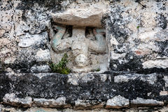 Ancient Mayan carving of the `diving god`. Over the door of the small temple building which crowns the Coba pyramid in Quintana Roo, Yucatan, Mexico Stock Photos