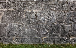 Ancient Mayan carvings at the Great Ball Court in Chichen Itza. Ancient Mayan mural at the Great Ball Court in Chichen Itza depicting headless body of a player Stock Photo