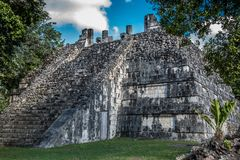 Stunning tulum mexico ancient civilization. Ancient mayan civilization in mexico called tulum in december 2017. Blue sky and green grass. One of the 7 wonders of Royalty Free Stock Photography
