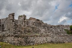 Stunning tulum mexico ancient civilization. Ancient mayan civilization in mexico called tulum in december 2017. Blue sky and green grass. One of the 7 wonders of Royalty Free Stock Photo