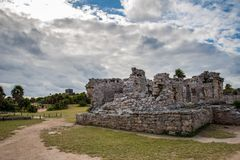 Stunning tulum mexico ancient civilization. Ancient mayan civilization in mexico called tulum in december 2017. Blue sky and green grass. One of the 7 wonders of Royalty Free Stock Image