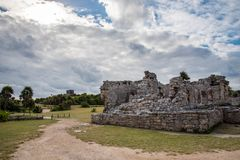 Stunning tulum mexico ancient civilization. Ancient mayan civilization in mexico called tulum in december 2017. Blue sky and green grass. One of the 7 wonders of Stock Photo