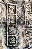 Ancient Mayan hieroglyphics. In stone, from the ruins Stock Photo