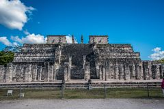 Stunning chichen itza mexico ancient civilization. Ancient mayan pyramid in yucatan mexico called chichen itza in december 2017. Blue sky and green grass. One of Stock Photo