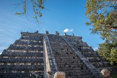 Stunning chichen itza mexico ancient civilization. Ancient mayan pyramid in yucatan mexico called chichen itza in december 2017. Blue sky and green grass. One of Royalty Free Stock Photo