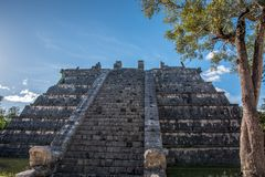 Stunning chichen itza mexico ancient civilization. Ancient mayan pyramid in yucatan mexico called chichen itza in december 2017. Blue sky and green grass. One of Royalty Free Stock Image