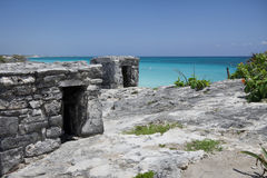 Ancient Mayan ruin perched on a rocky shoreline Royalty Free Stock Image