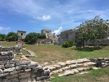 Ancient Mayan ruins near the ocean In Tulum, Mexico. The ancient mayan ruins  of Tulum, Mexico are breathtaking and awesome.  Located right by a beautiful Royalty Free Stock Photo