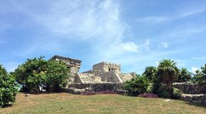 Ancient Mayan ruins near the ocean In Tulum Mexico. The ancient mayan ruins  of Tulum, Mexico are breathtaking and awesome.  Located right near the shoreline Stock Photo