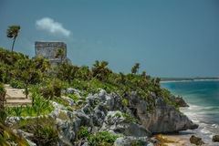 The Ancient Mayan Ruins by the ocean in Tulum Mexico. Pre columbian mayan ruins located by the ocean at tulum mexico in the Yucatán Peninsula stock images