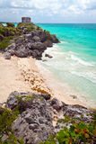 Ancient Mayan ruins temple on the beach of Tulum. Mexico royalty free stock photo