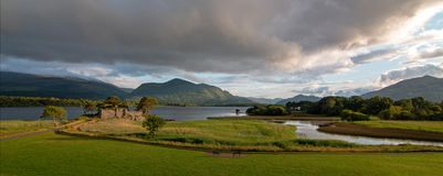 Ancient McCarthy Mor castle on Lake Lough Leane at Killarney on the Ring of Kerry in Ireland. IRE royalty free stock image