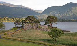 Ancient McCarthy Mor castle on Lake Lough Leane at Killarney on the Ring of Kerry in Ireland. IRE royalty free stock photo