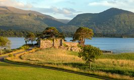 Ancient McCarthy Mor castle on Lake Lough Leane at Killarney on the Ring of Kerry in Ireland. IRE royalty free stock photography