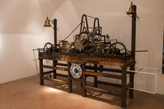 An ancient mechanical clock whose gears take up a whole table. It is one of the oldest clock engineering example stock photography