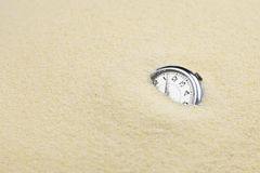 Ancient mechanical watch in sand Stock Images