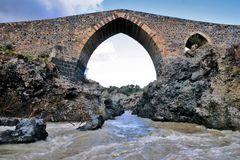 Ancient medieval bridge of Norman age in Sicily. Front view of the ponte dei saraceni (saracen's bridge), an ancient medieval bridge of Norman age located on the Stock Photos