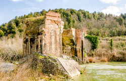 Ancient Medieval Bridge over a Creek in the Tuscany Countryside.  Royalty Free Stock Photo
