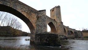 Ancient medieval bridge on a rainy day in Frias, Burgos, Spain. stock video