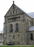 Ancient medieval cathedral in Lund, Sweden. Lund, Sweden - April 21, 2017: people are walking at ancient medieval cathedral in Lund, Sweden stock photos