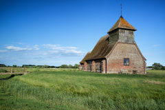 Ancient Medieval church landscape against evening Summer sky Stock Image