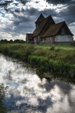 Ancient Medieval church landscape against evening Summer sky Royalty Free Stock Photo
