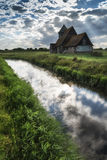 Ancient Medieval church landscape against evening Summer sky Stock Images