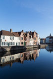 Ancient Medieval Houses near Canal and Water Reflection in Bruges Royalty Free Stock Photos