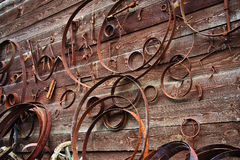 Ancient medieval rusty metal hardware and forged rim on a wooden wall Stock Photography