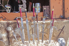 Ancient medieval swords. Outdoor scene with some ancient medieval swords Stock Images