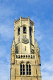 Ancient tower with clock in Bruge, Belgium Stock Image