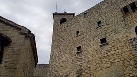 Castle wall and tower. Ancient and medieval wall of italian castle. Historical wonderful site royalty free stock photo