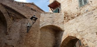Castle wall and tower. Ancient and medieval wall of italian castle. Historical wonderful site royalty free stock image
