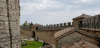 Castle wall and tower. Ancient and medieval wall of italian castle. Historical wonderful site stock images