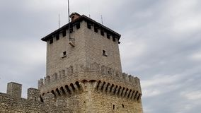 Castle wall and tower. Ancient and medieval wall of italian castle. Historical wonderful site royalty free stock photography