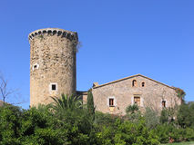 Ancient mediterranean manor with watchtower (Costa Brava, Spain). Ancient manor and watchtower build near the mediterranean sea in the 16th century to watch the Stock Image
