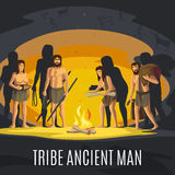 Ancient men making fire in cave Stock Image