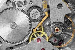 Ancient metal clockwork close up background. Ancient tiny metal clockwork close up background Stock Photos