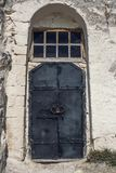 Ancient metal door locked with a padlock in old temple Royalty Free Stock Image