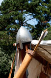Ancient metal helmet and archery Stock Photos