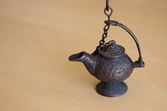 Ancient metal oil lamp Stock Photo