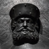 The ancient metal portrait of man with beard Royalty Free Stock Photo