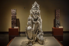 Ancient mexican skulpture in traditional clothing Stock Photo