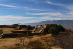 Ancient Mexican Temple on a Dramatic Landscape. Amazing remains of a Zapotec temple atop a flattened mountain in a dramatic landscape in the State of Oaxaca Stock Photography