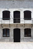 Ancient military building. An ancient military building recently renovated with doors and windows stock photography