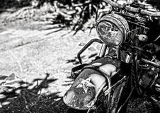 Ancient military motorcycle in the rainforest. Black-white photo Royalty Free Stock Photo