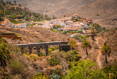 Ancient mill and aqueduct in Fataga Stock Images