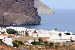 Ancient mill and Las Negras in Andalusia, Spain Stock Photography
