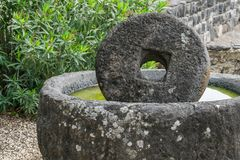 Ancient mill stone. For olive oil Stock Photography